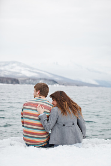 Cozy winter engagement photography on a frozen lake